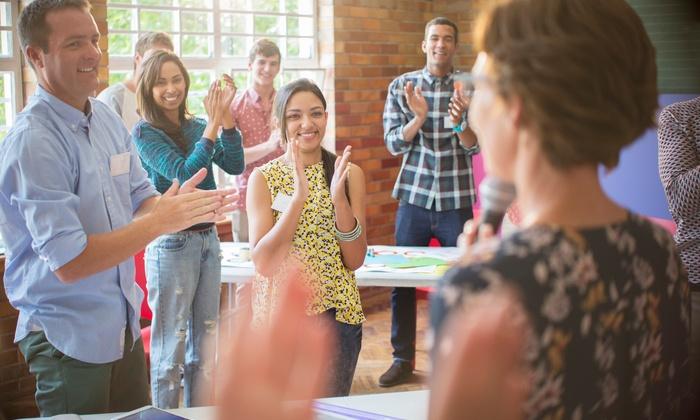 coaching de groupe avec participants souriants
